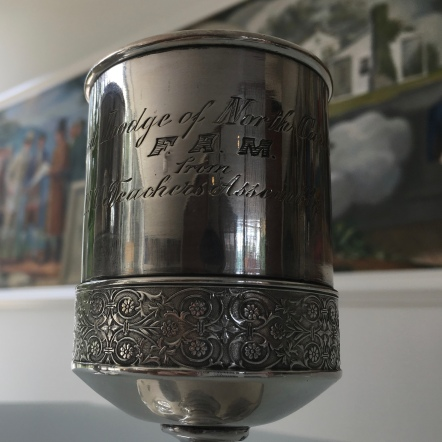 One of the original cups used to dedicate the cornerstone of what is today Holiday Hall.