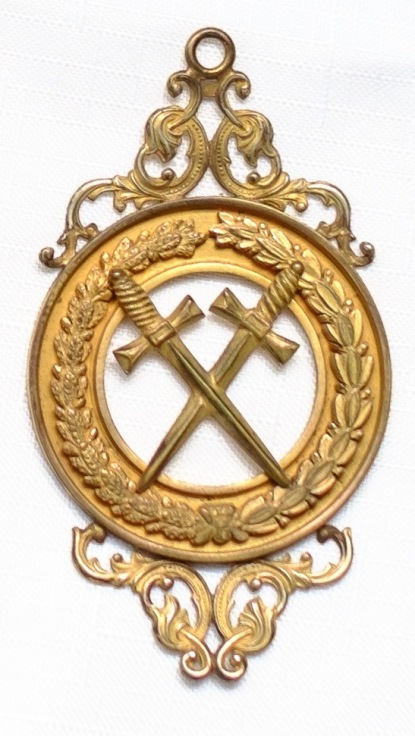 The jewel of the Grand Sword Bearer, worn by William A. Withers at the cornerstone dedication of what is now Holiday Hall in 1888. Photograph courtesy of the Grand Lodge of A.F. & A.M. of NC